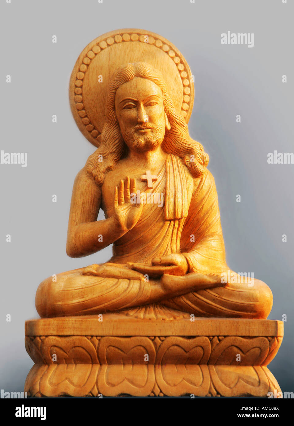 India, Patna, 25.11.2007: statue of Jesus Christ in a buddhist sitting position - Stock Image