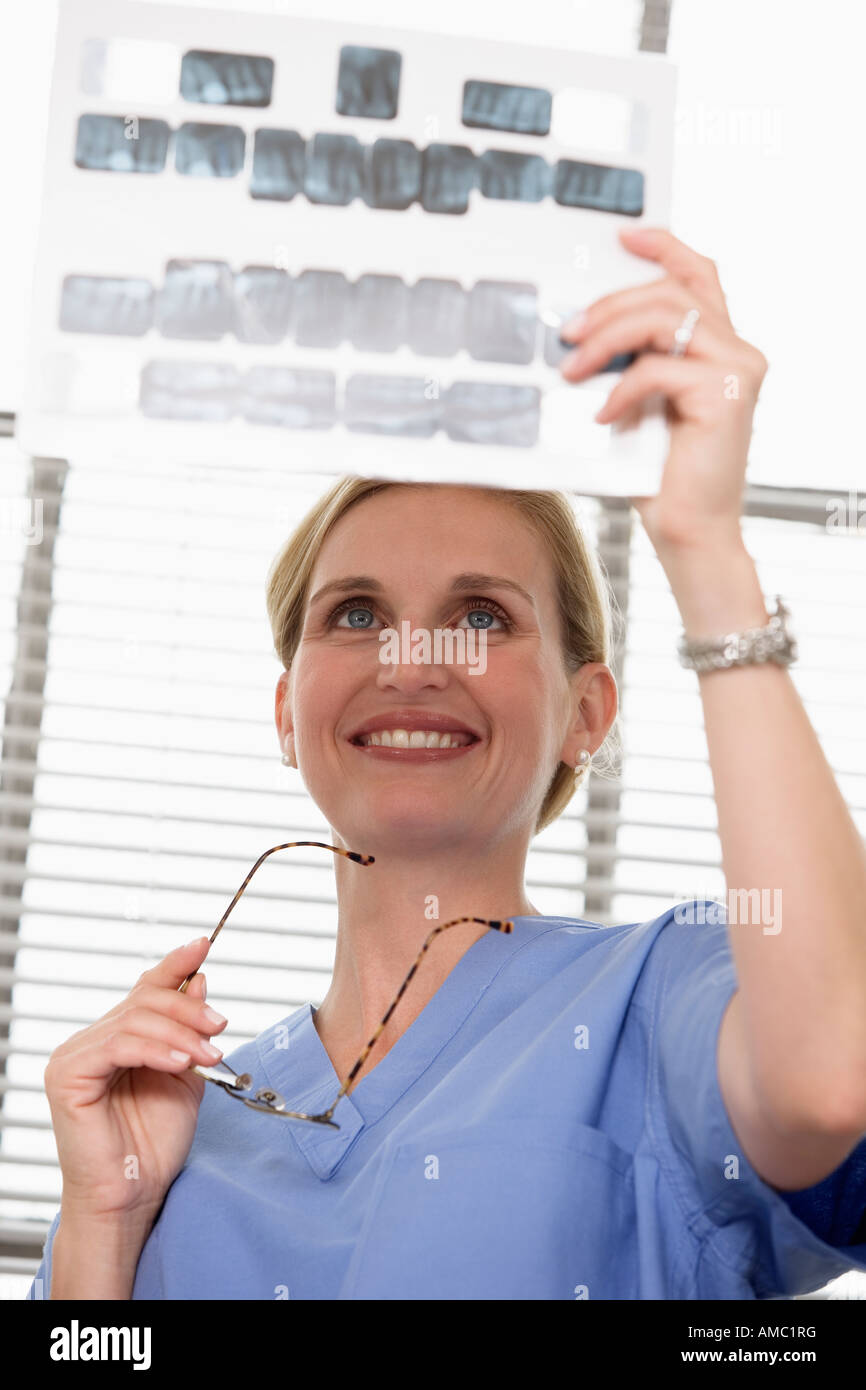 View of a doctor checking xrays. - Stock Image