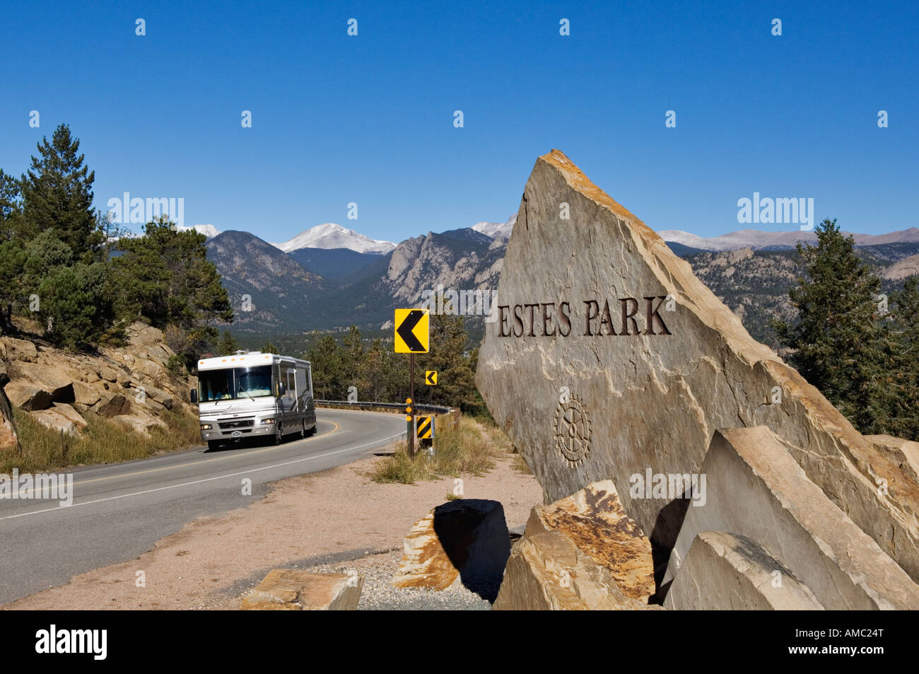 RV Driving Past Estes Park Stone City Marker with the Rocky