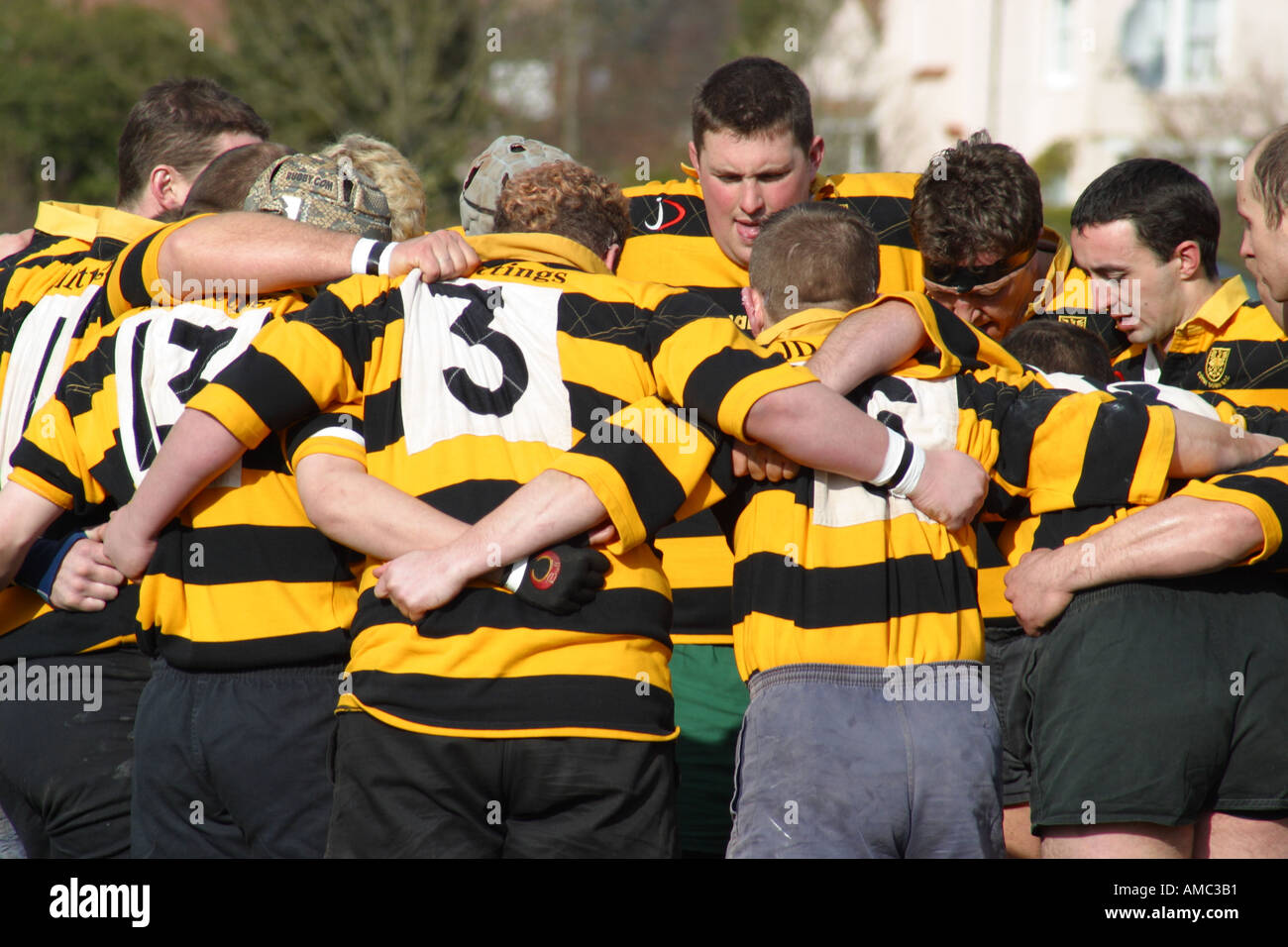 Rugby players gather together for a pre match team talk - Stock Image
