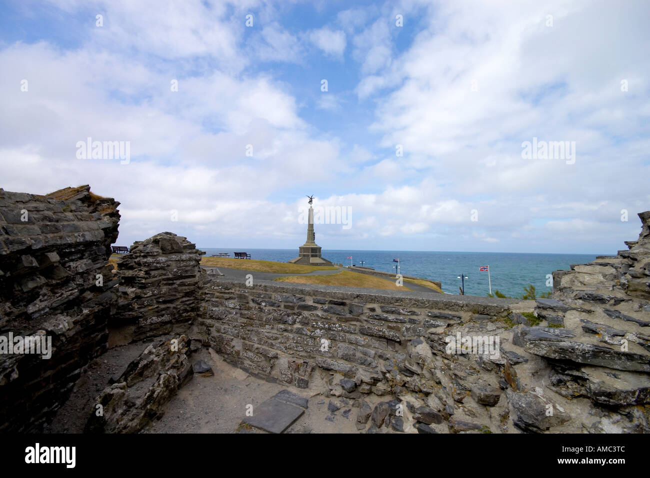 the war memorial looking from the castle on the seafront of Aberystwyth in Mid Wales - Stock Image