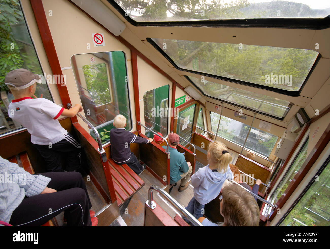 visitors on board the water powered Cliff Railway at the Centre for Alternative Technology Machynlleth Wales - Stock Image