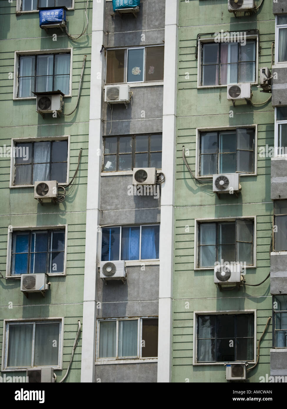 Detailed view of windows in apartment building with air ...