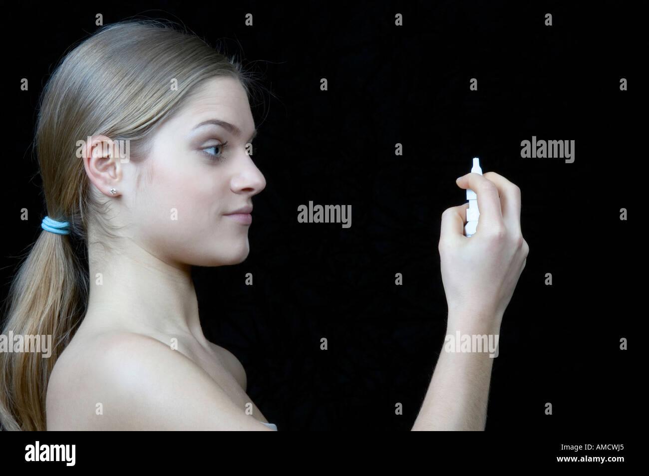 Woman taking nose drop Stock Photo