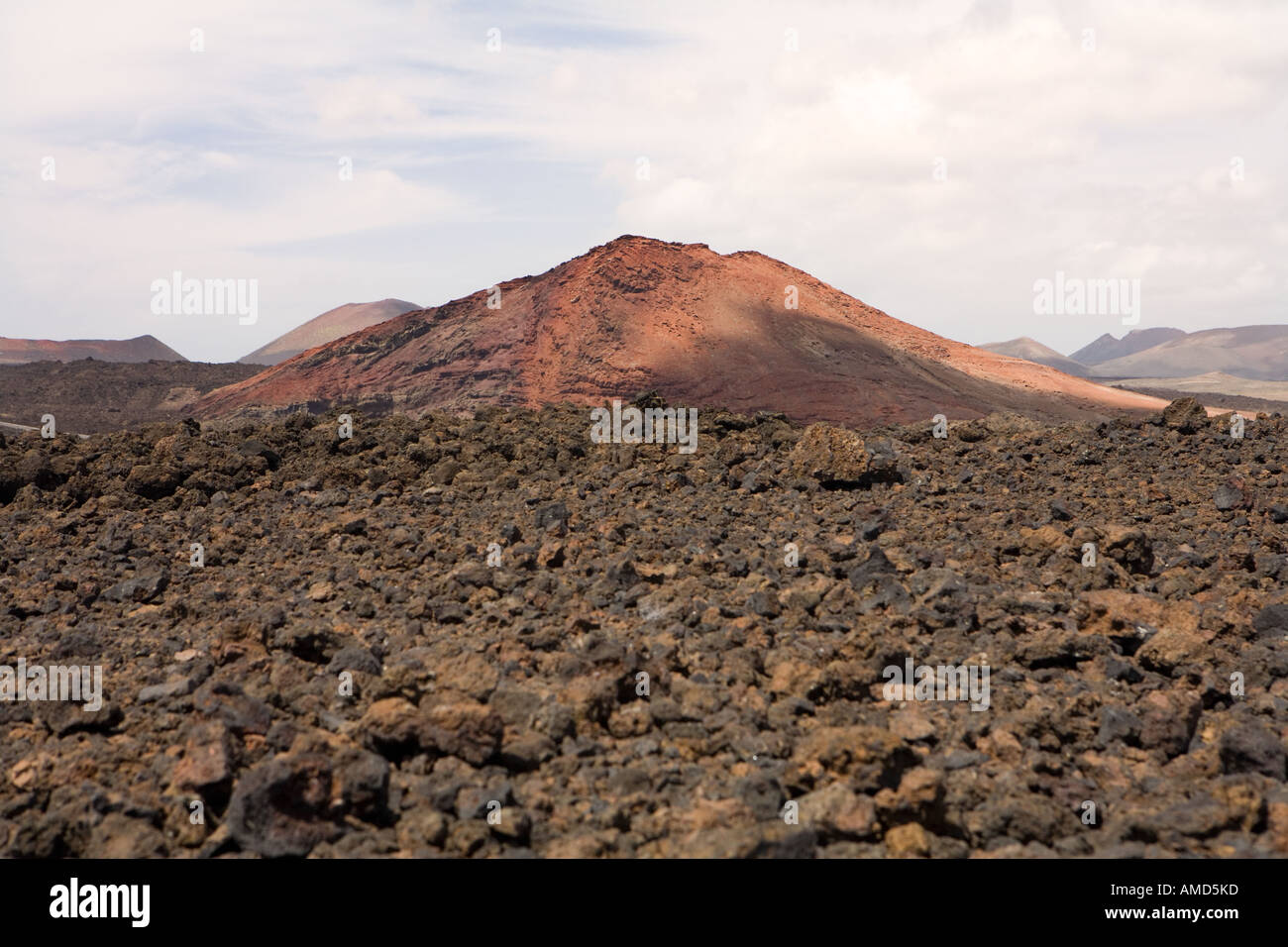 red volcano near Timanfaya park Lanzarote Canary Islands Spain - Stock Image