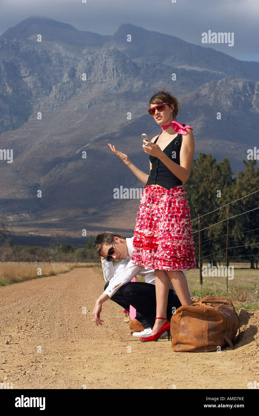 Couple Stranded On Country Road Stock Photo
