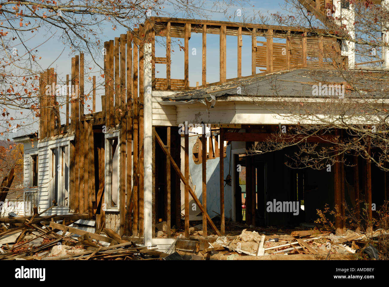 An old house being torn down. - Stock Image