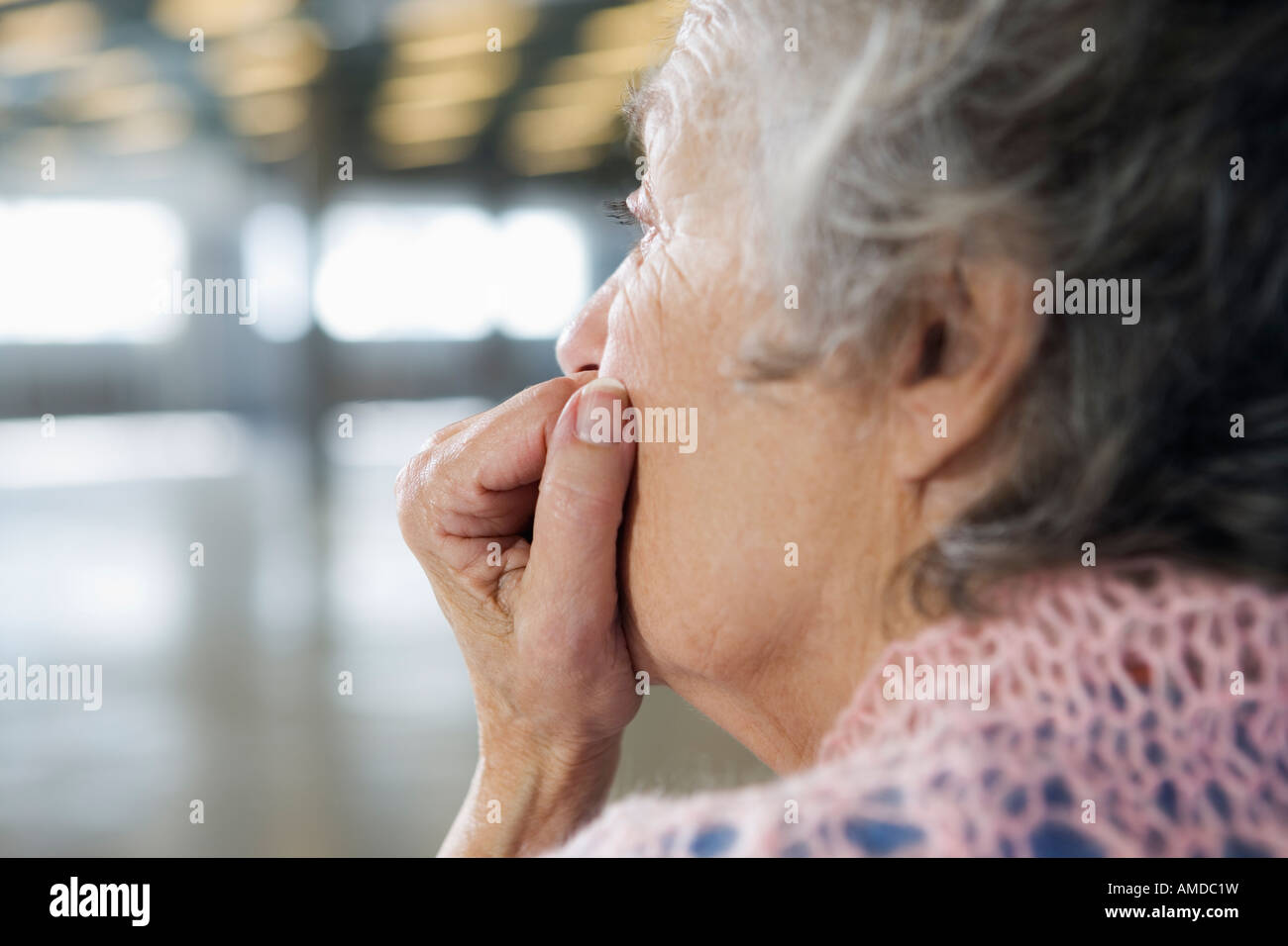 Close up of a depressed old woman. - Stock Image