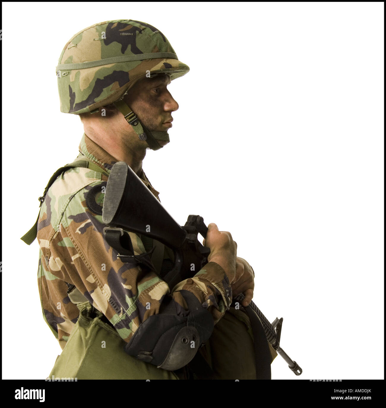 Soldier in uniform with gun - Stock Image