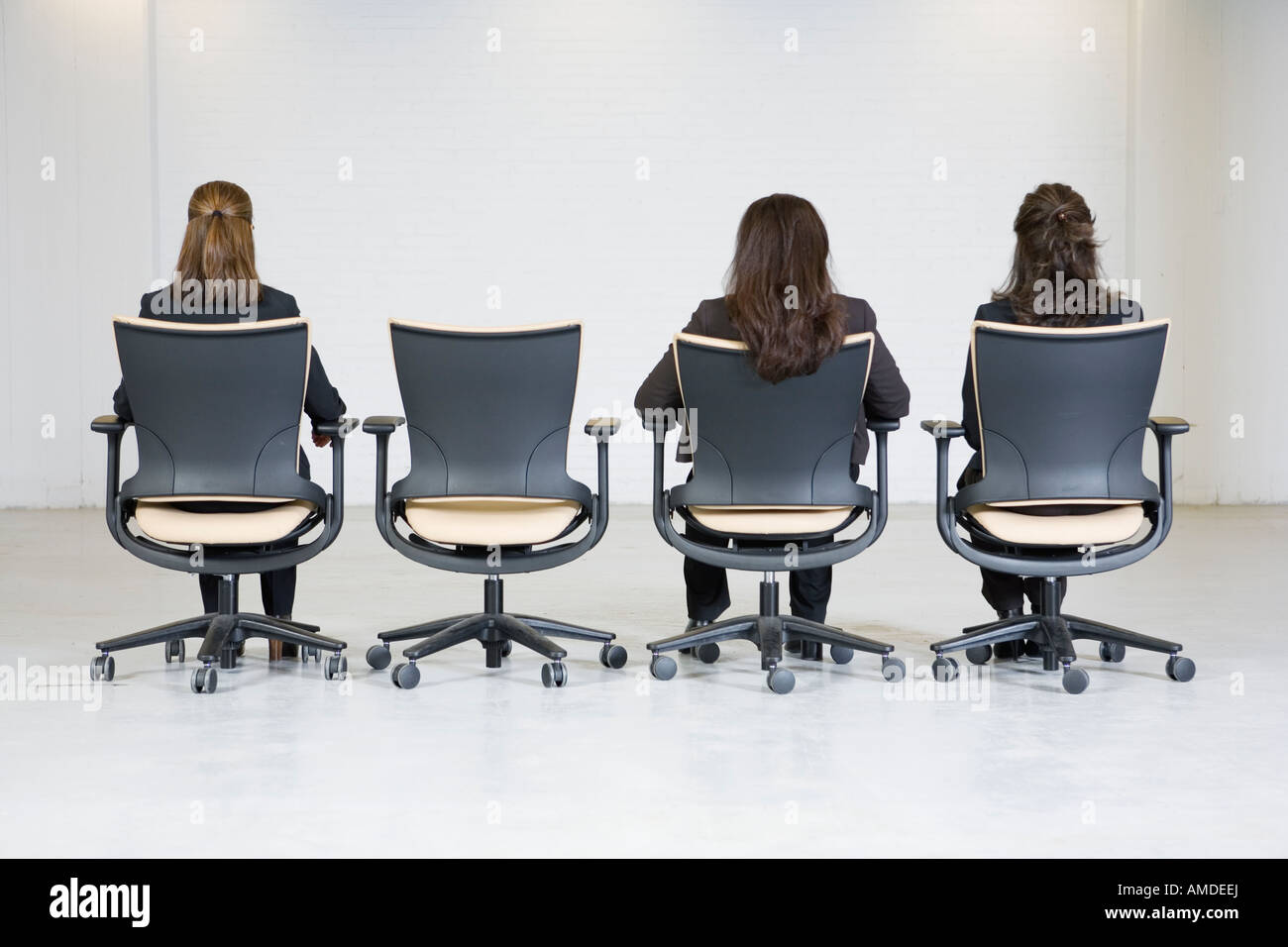 office furniture for women. Rear View Of Business Women Sitting On Office Chairs. Furniture For R