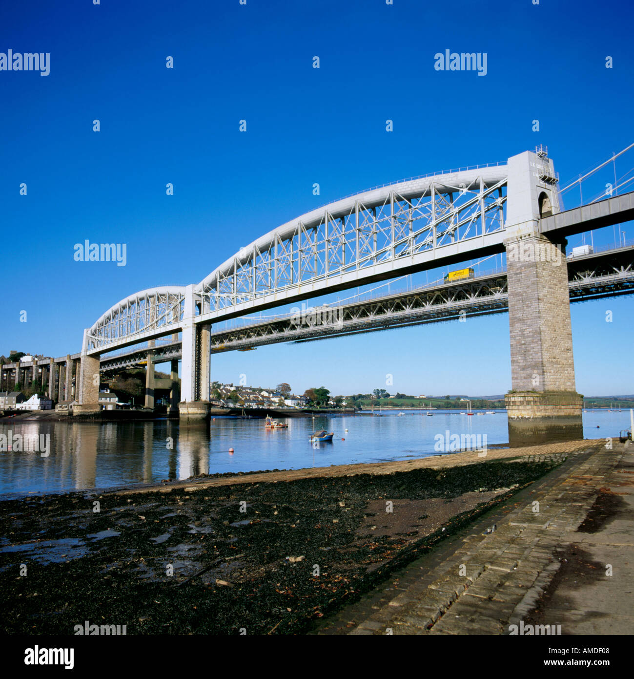 Rail and road bridges over the River Tamar between Devon and Cornwall, from the Plymouth shore, England, UK. - Stock Image