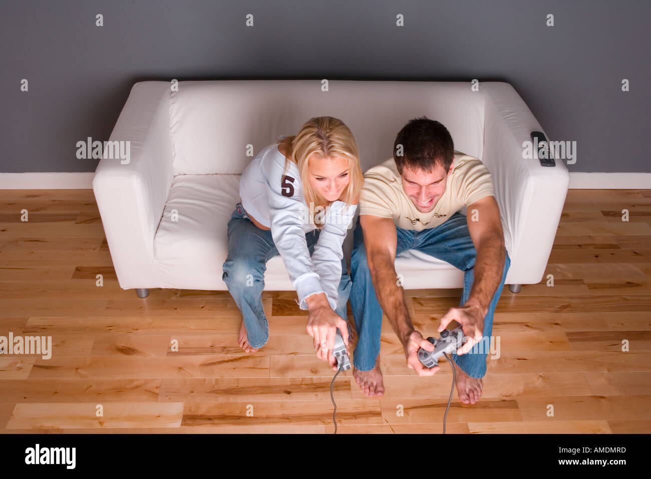 Young couple playing video game - Stock Image