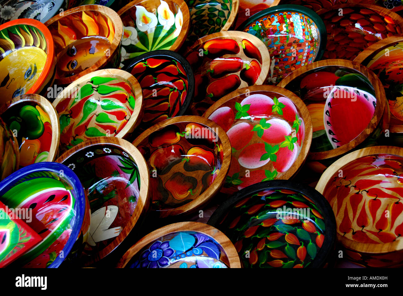 North America, Mexico, State of Guerrero, Acapulco. Colorful wooden bowls hand painted with traditional designs. - Stock Image