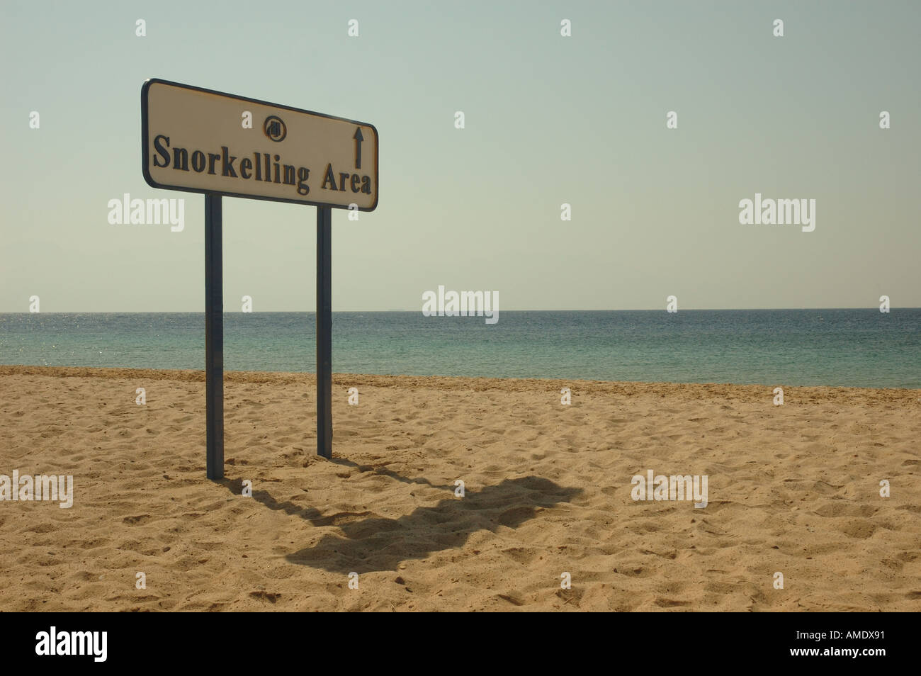 Sign showing the way to the snorkelling area at the Coral Hilton Resort in Nuweiba Egypt Stock Photo