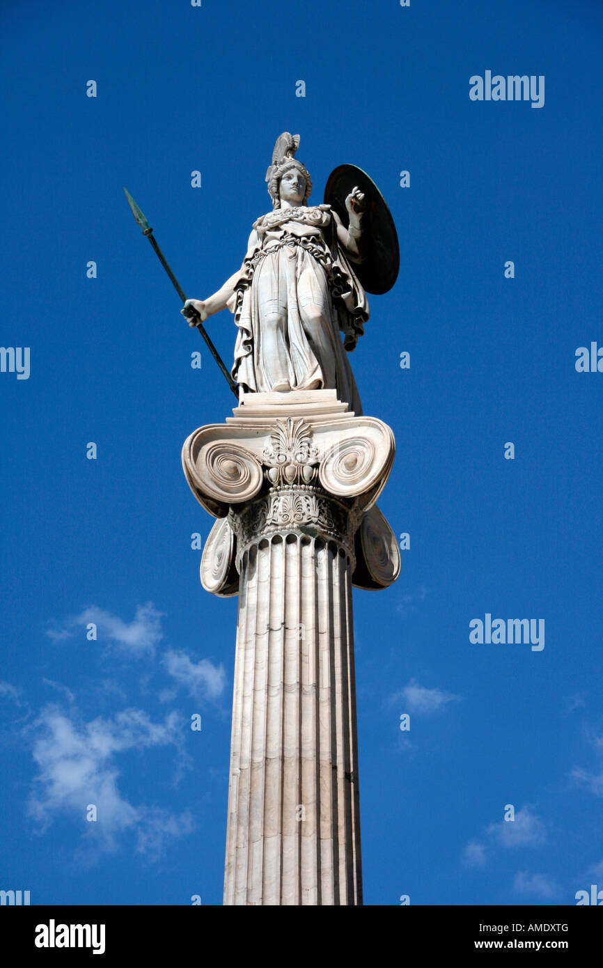 the statue of goddess athena on a tall corinthian pillar in front of the university of athens greece on total blue - Stock Image