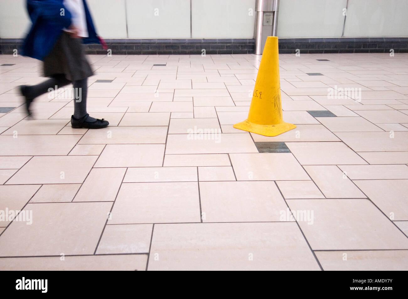 slippery floor in shopping mall - Stock Image