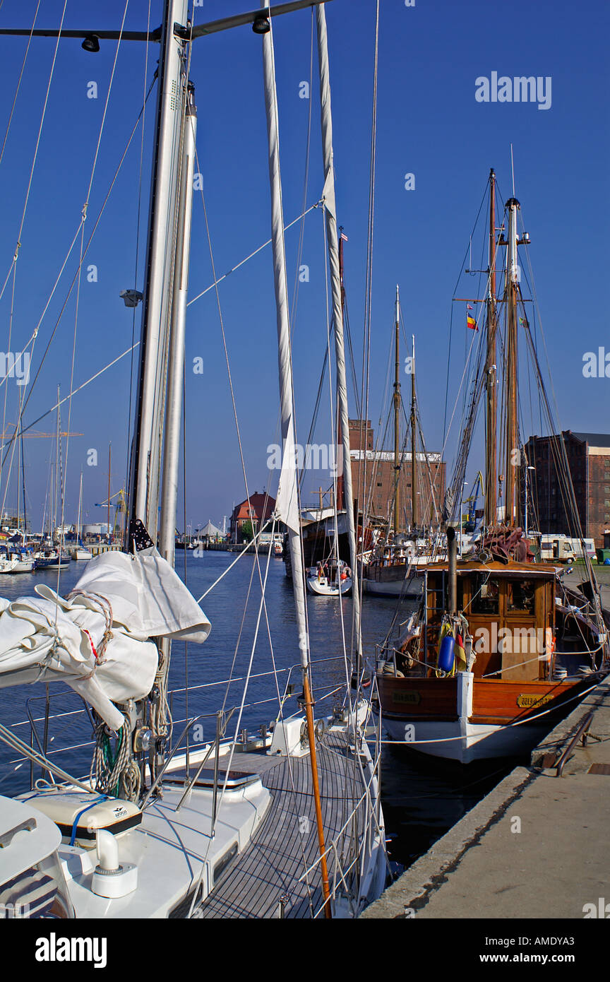 habor Wismar sailing boat new and old - Stock Image