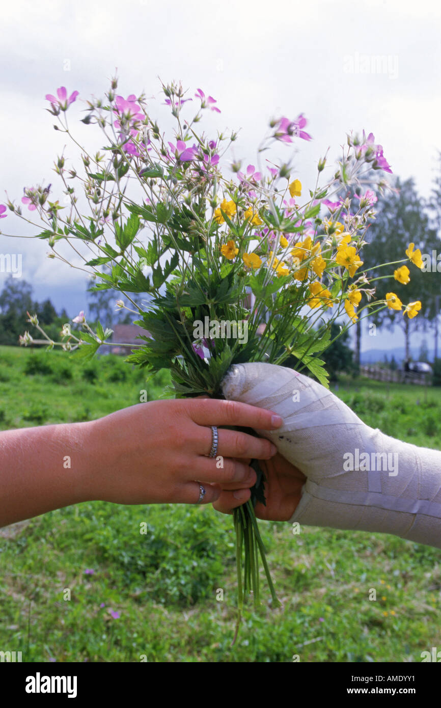 Hand Giving Bouquet Summer Flowers Stock Photos & Hand Giving ...