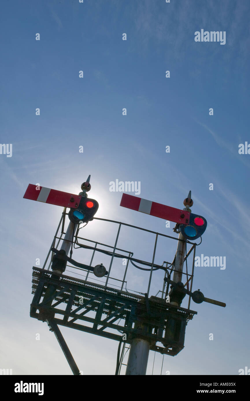 TWO RAILWAY SIGNALS ON GANTRY - Stock Image