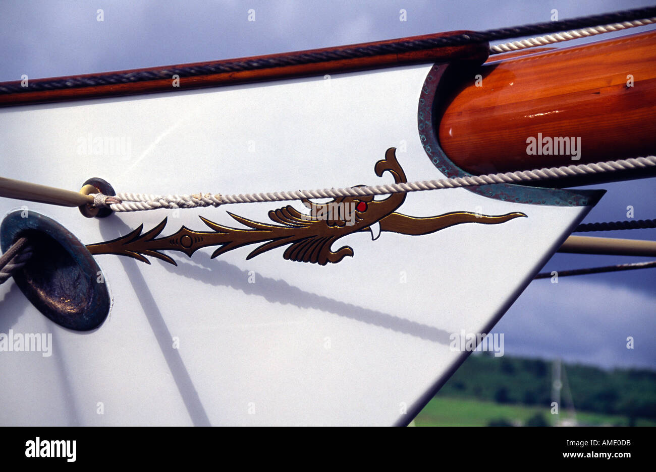 Dragon detail on bow of Fife designed classic yacht Belle Aventure rhu marina scotland Stock Photo