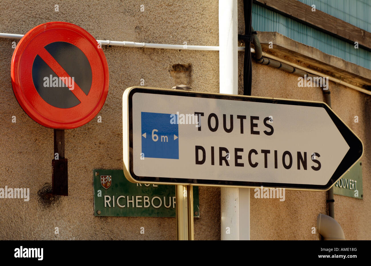 French Road Signs for All Directions and No Waiting - Stock Image