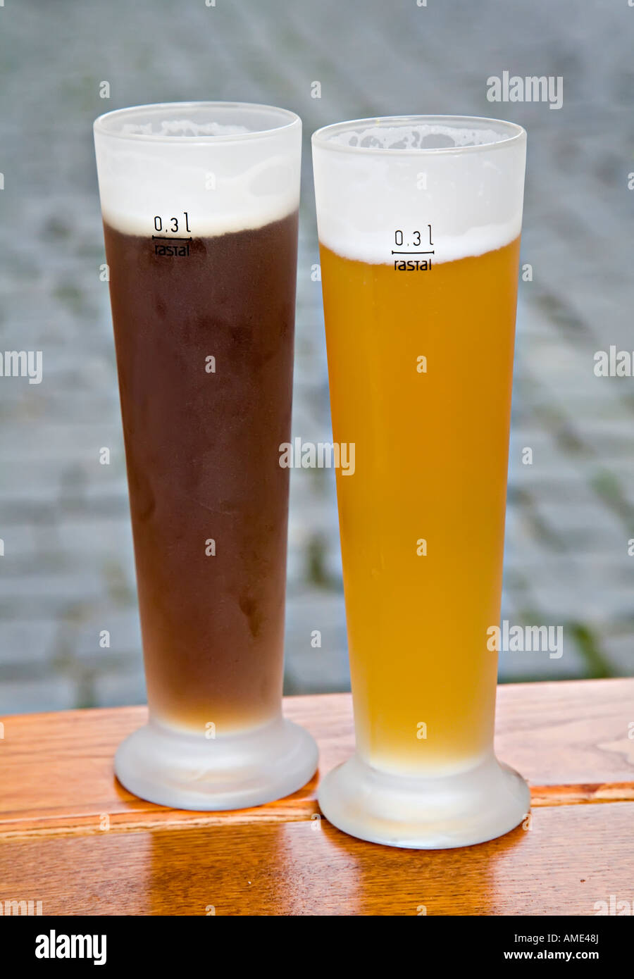 Dark and light German lager beer in tall glasses with volume rastal marks Germany - Stock Image