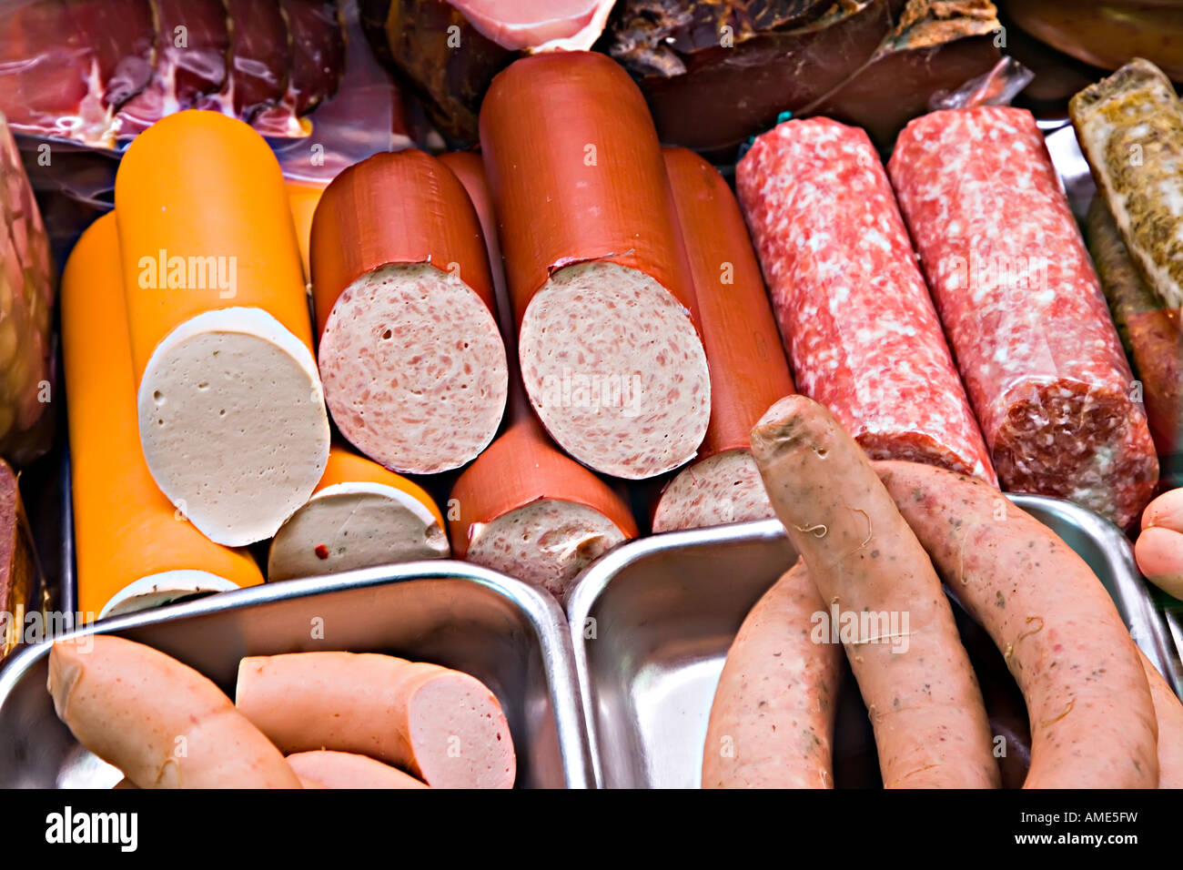 Smoked meat German sausage and salami on sale in butcher's