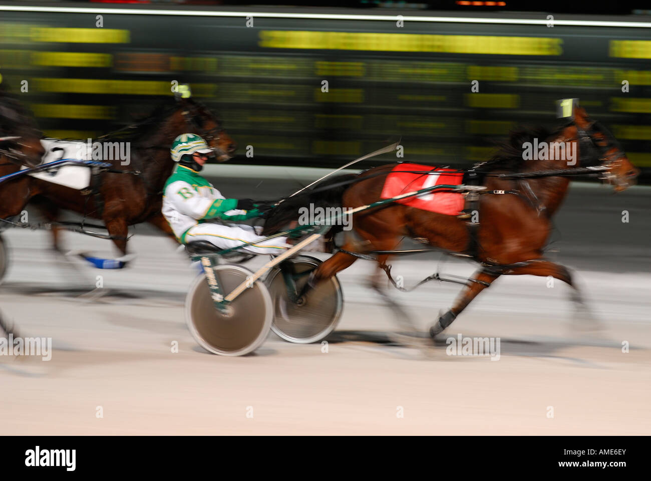 Number one harness racer breaks away at finish line to win at night in winter Ontario - Stock Image