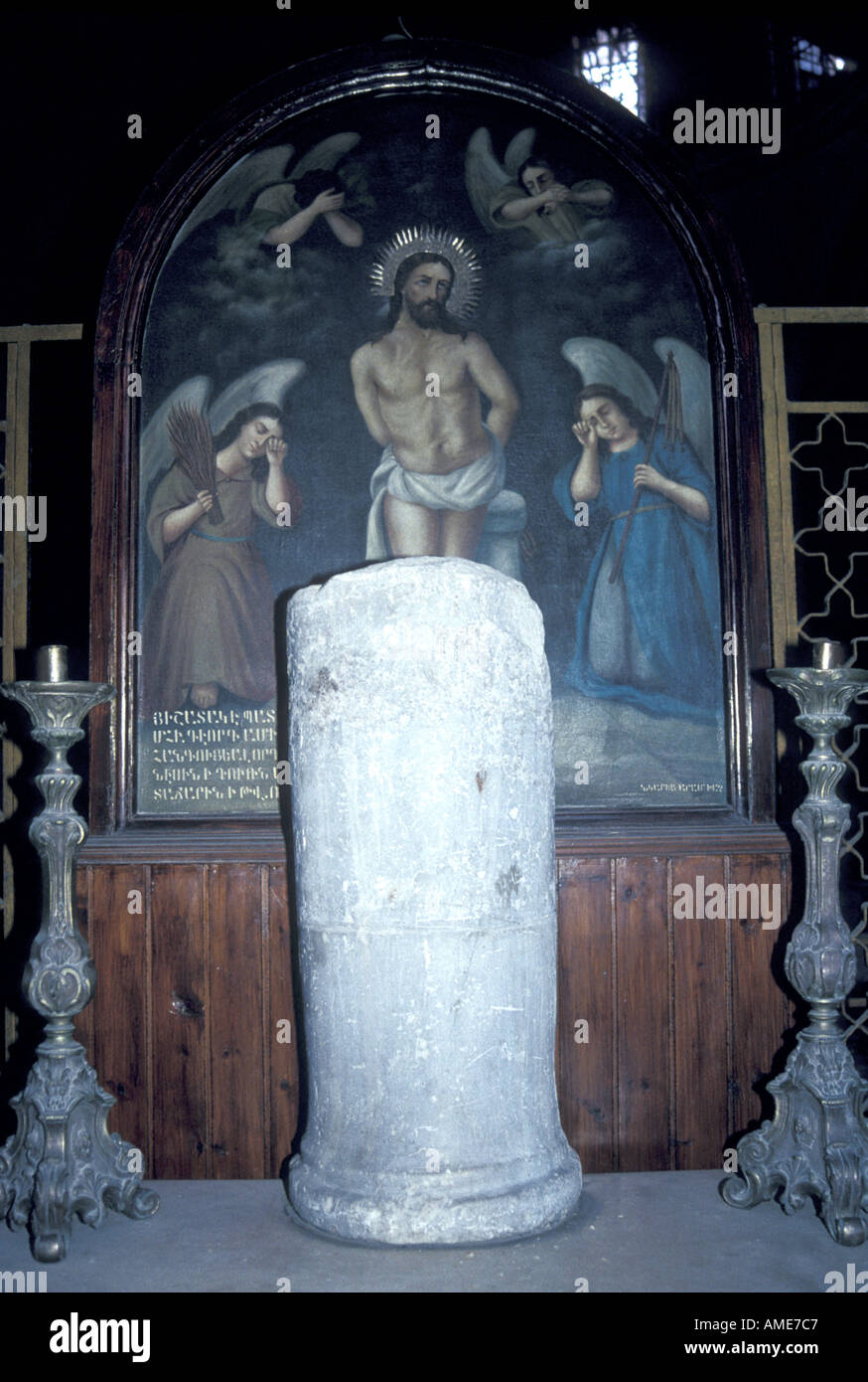 Marble pillar where Christ was tied, located in the Armenian Chapel, Church of the Holy Sepulchre Jerusalem - Stock Image