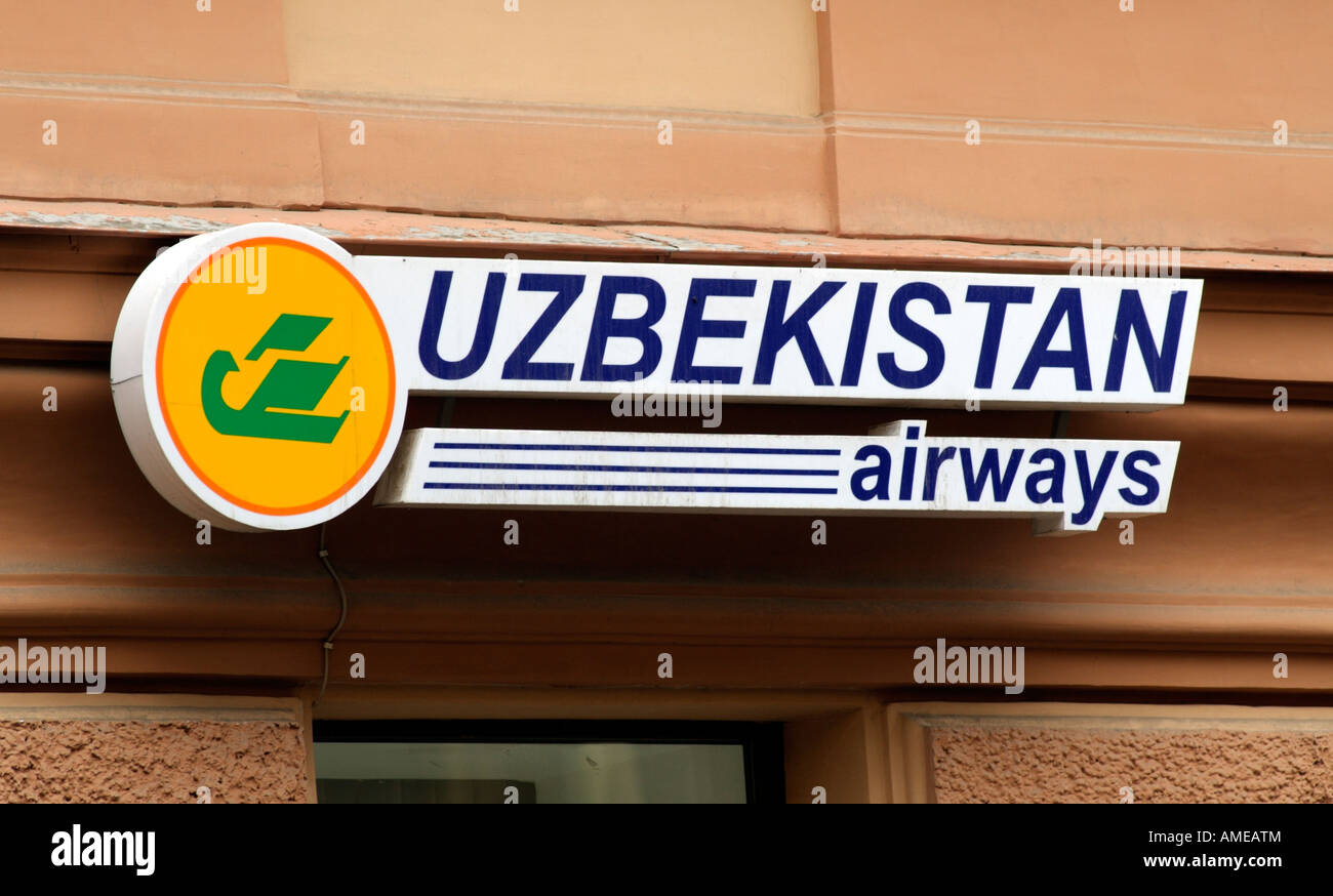Uzbekistan Airways Company Sign on a Building in St Petersburg Russia - Stock Image