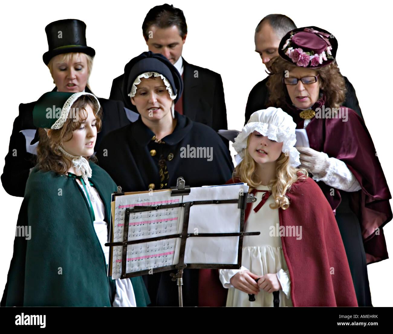 Group Of Victorian Carol Singers Wth Sheet Music At Christmas Uk