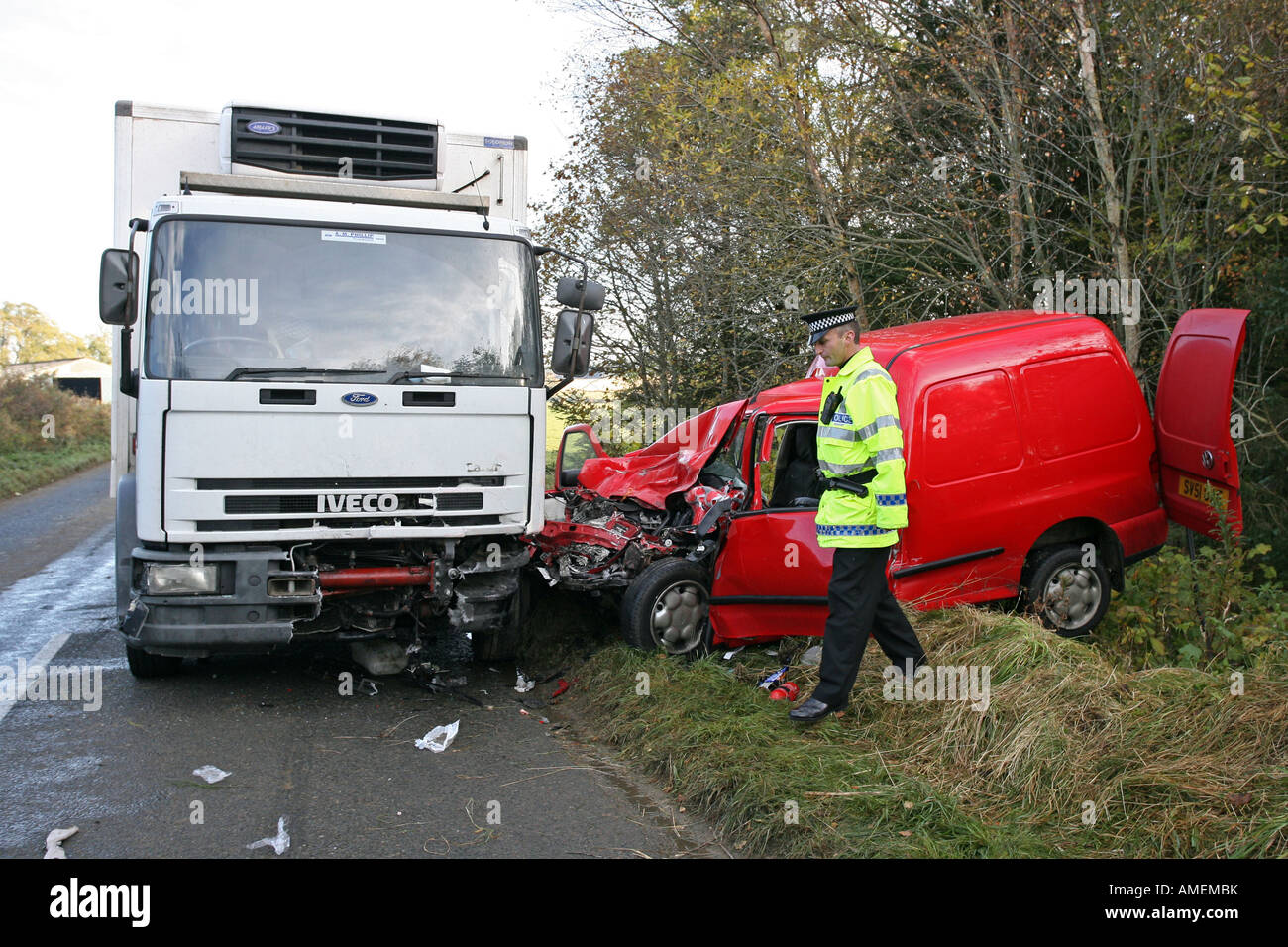 Road traffic crash between a lorry and a red van on minor road in Aberdeenshire, Scotland, with Grampian Traffic Stock Photo