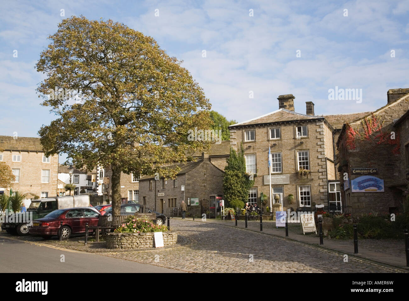 Traditional old stone building in village square in Yorkshire Dales National Park, Grassington Yorkshire England UK Stock Photo