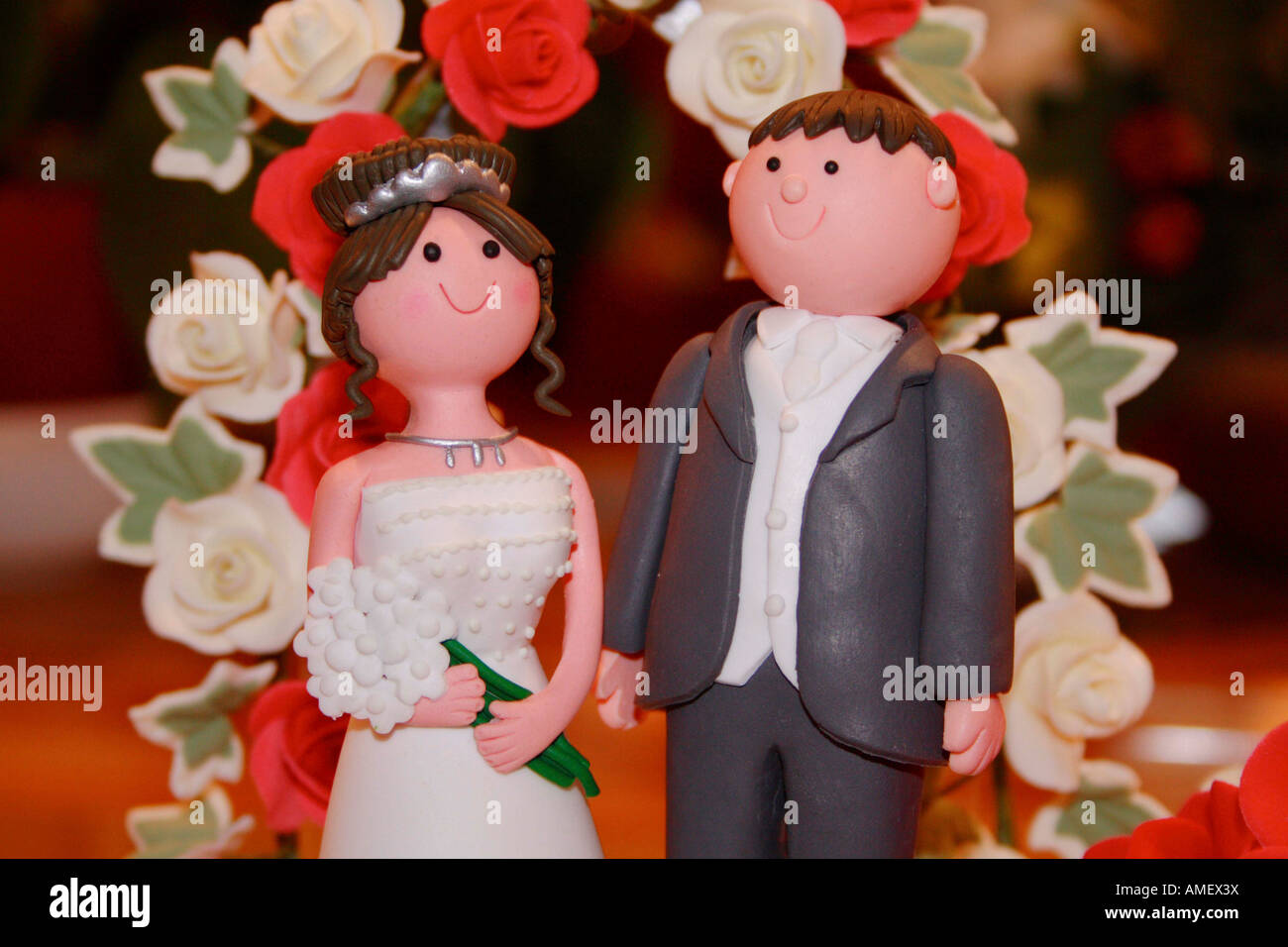 Bride and groom on top of a wedding cake Stock Photo
