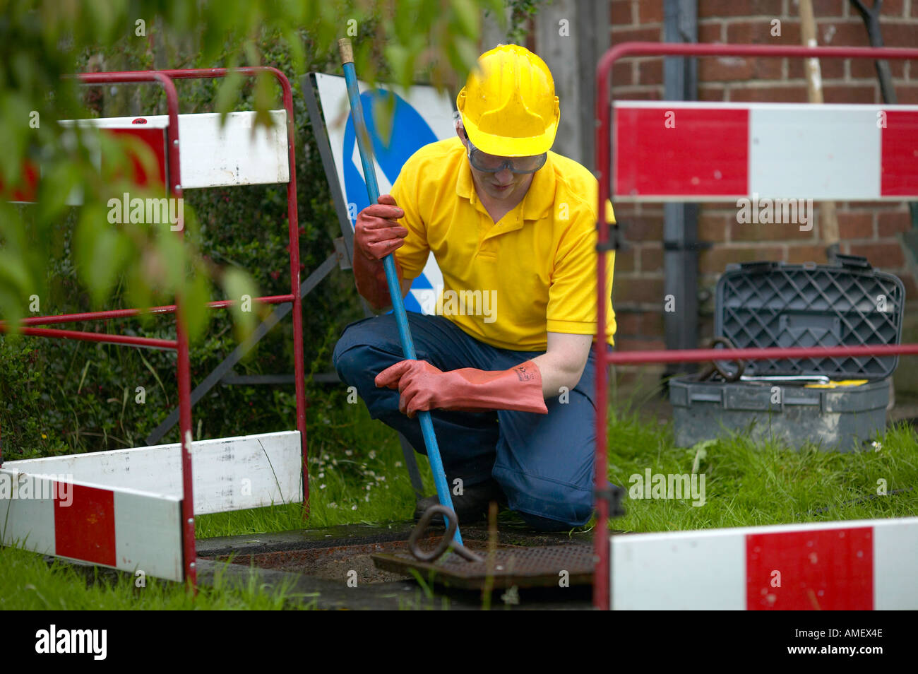 Man cleaning drains - Stock Image