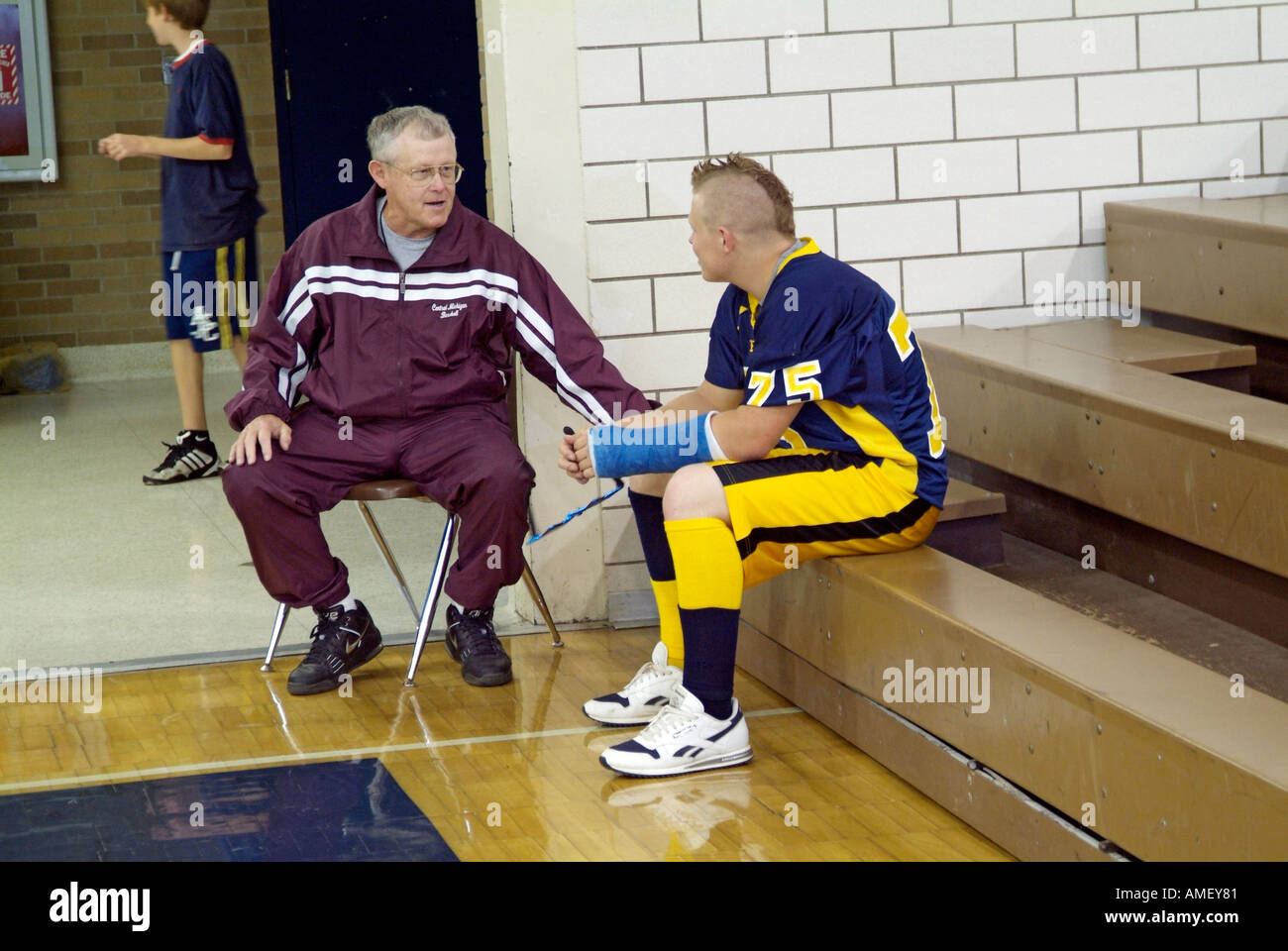 Coach talks with injured football player - Stock Image
