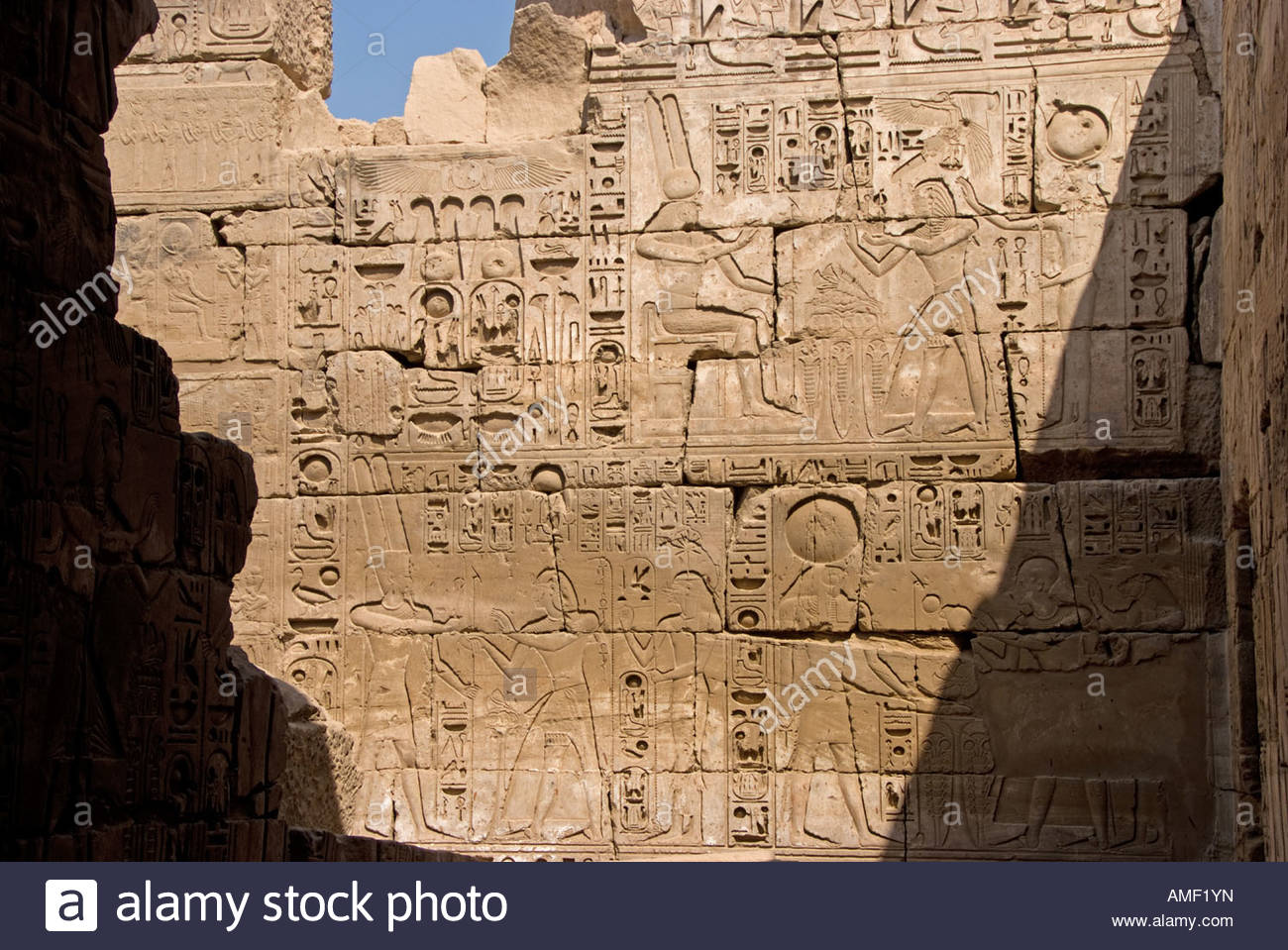 Egyptian carvings on interior wall of khonsu temple at