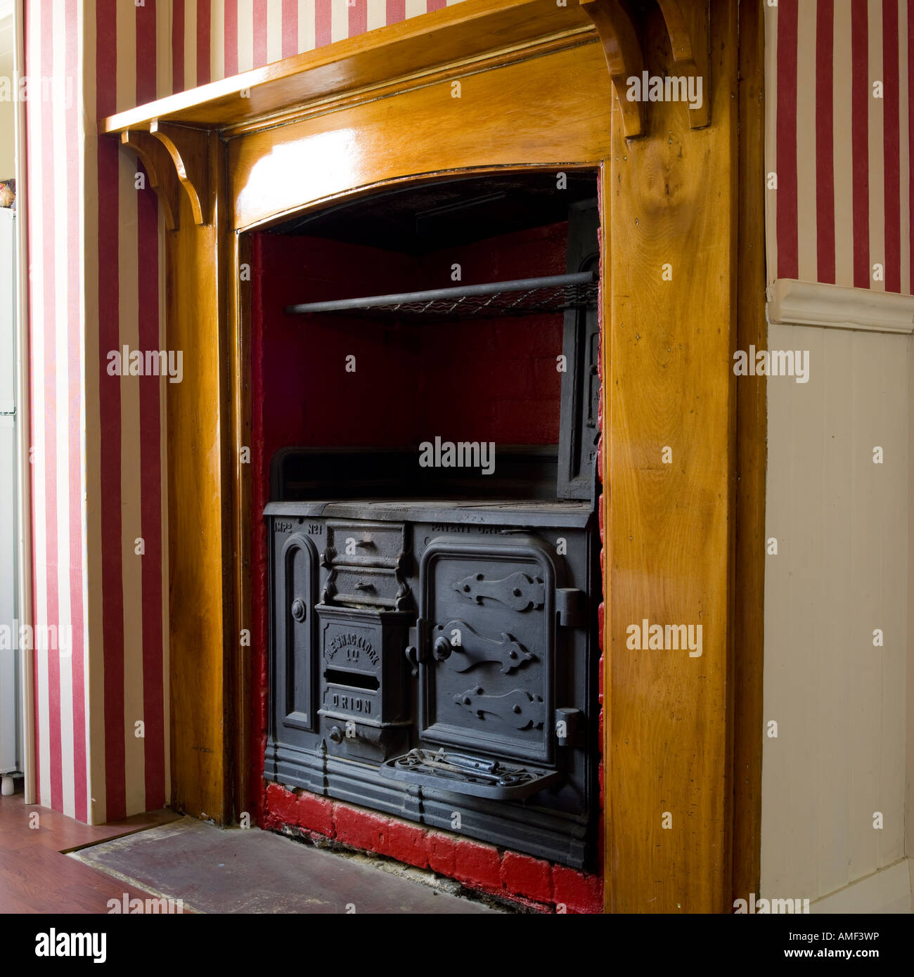Old fire range in kitchen - Stock Image