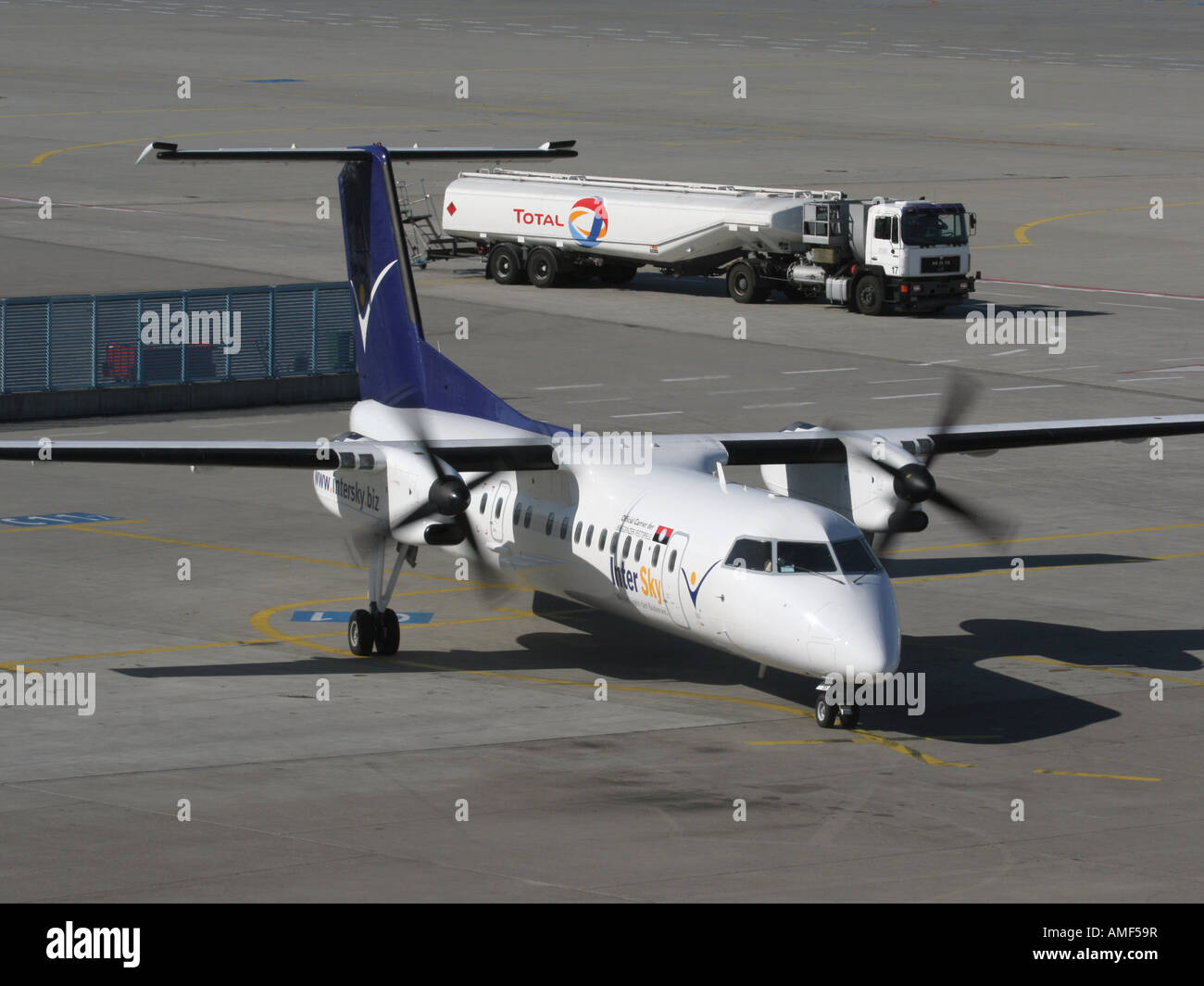 InterSky Bombardier Dash 8-Q300 on the ramp with fuel bowser - Stock Image
