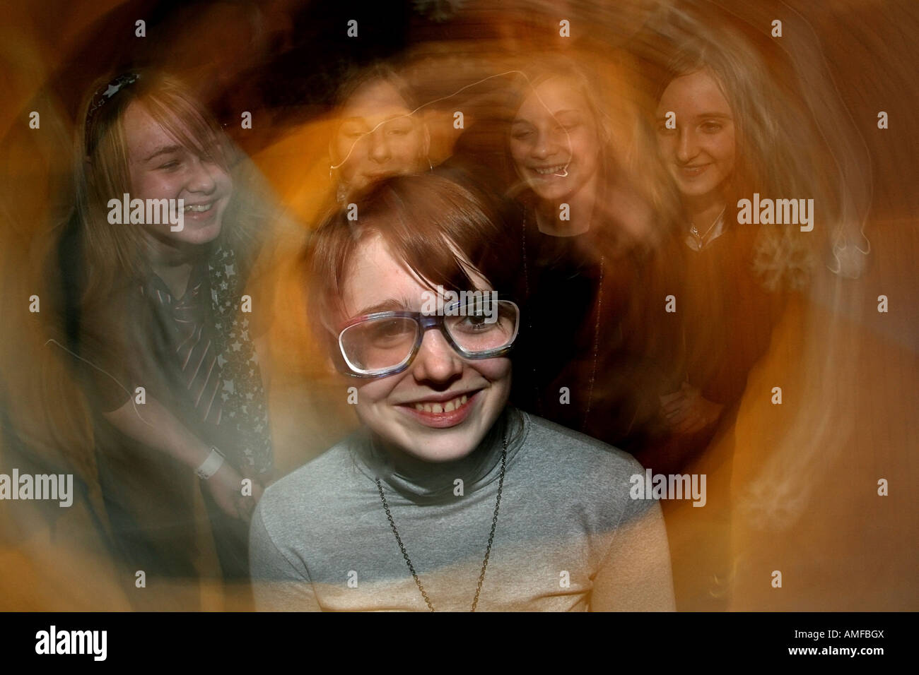 Girls try out beer goggles which give the wearer the experience of being under the effects of alcohol without drinking - Stock Image