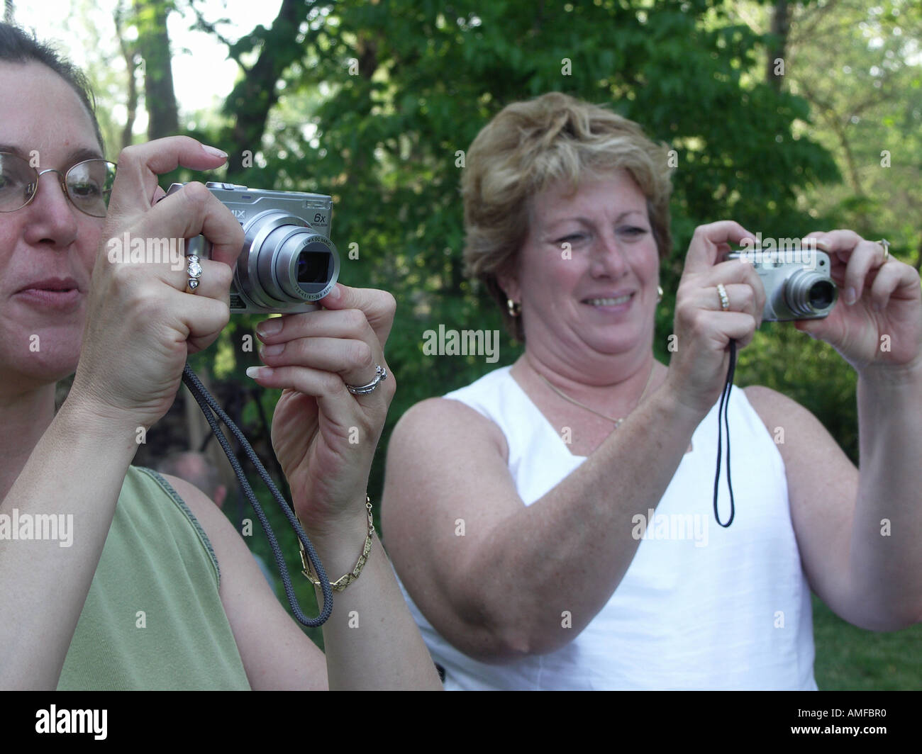 Women Taking Digital  Pictures Stock Photo