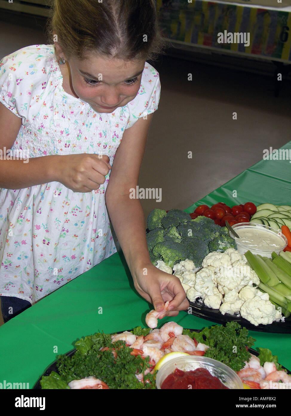 Enjoying Party Food - Stock Image