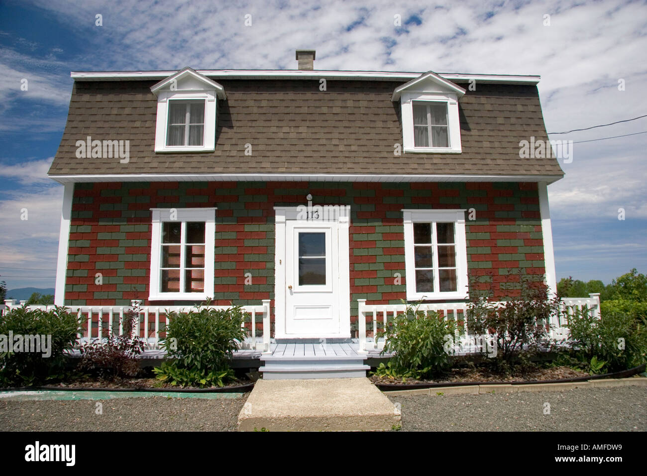 Cottage Style Homes In A Rural Area Along The St. Lawrence River At  Lu0027lslet, Quebec, Canada.