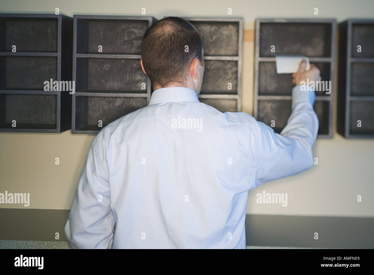 Business Man At Office Mail Slots