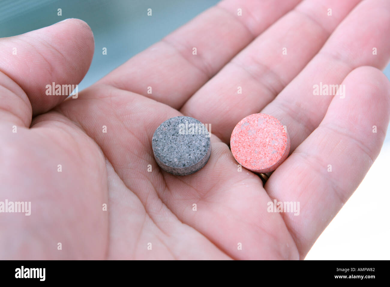antacid tablets in hand - Stock Image