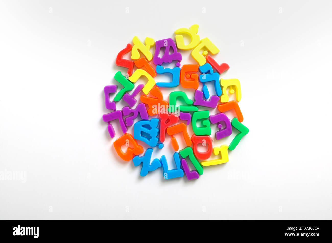kids hebrew aleph bet fridge magnets forming a globe - Stock Image