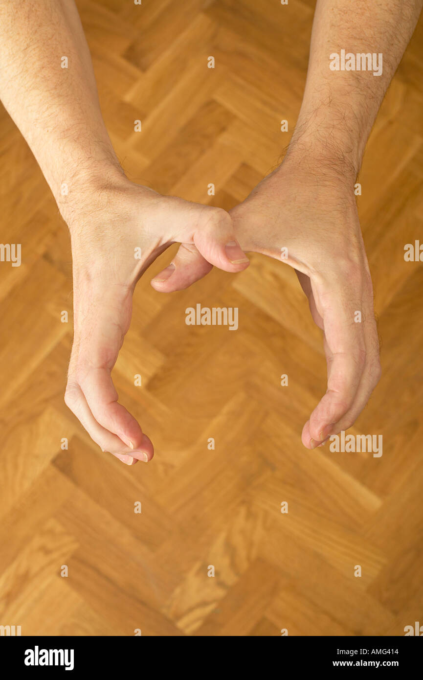 mans hands from above coming to strangle - Stock Image