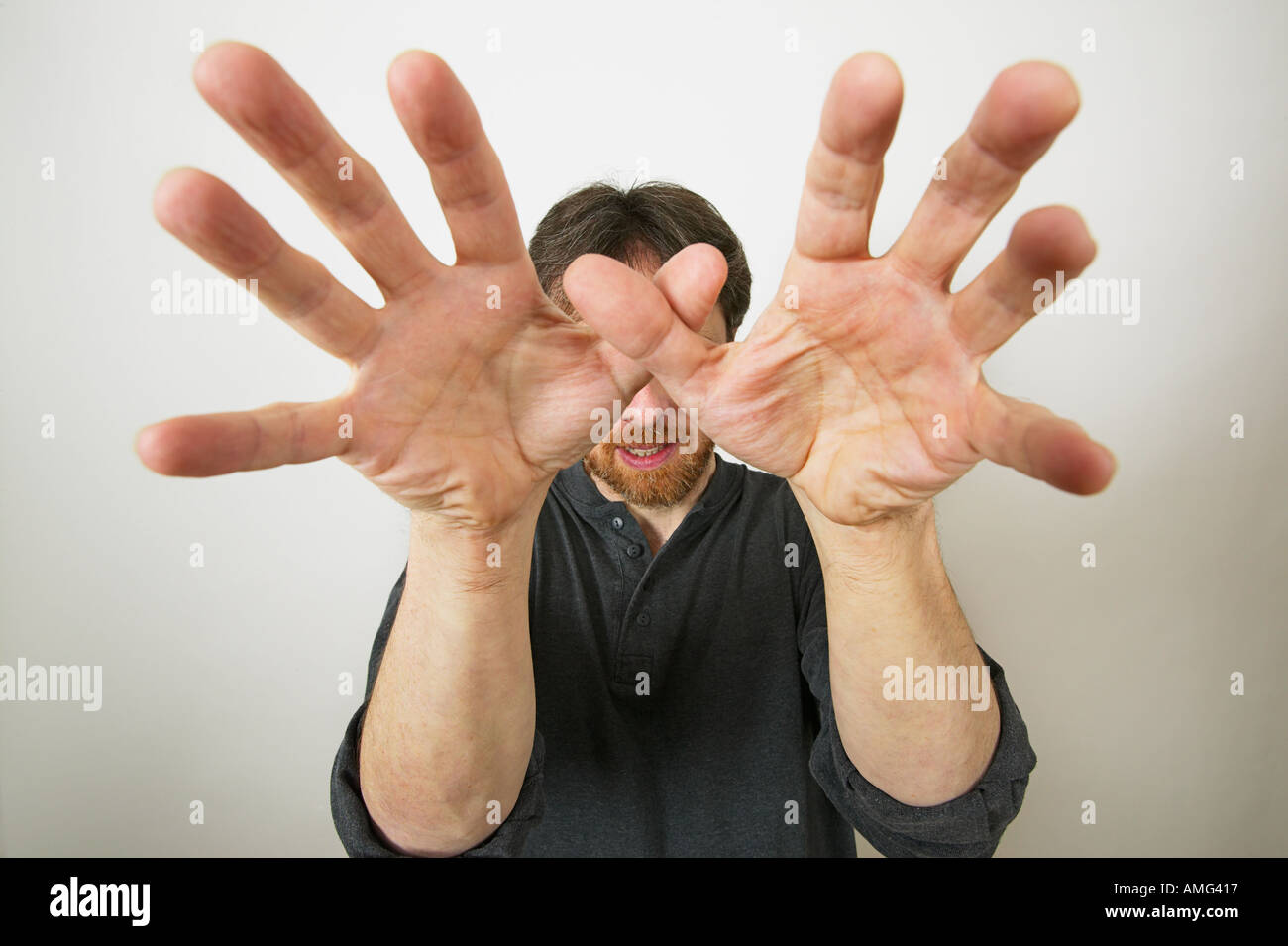mans hands towards coming to strangle - Stock Image