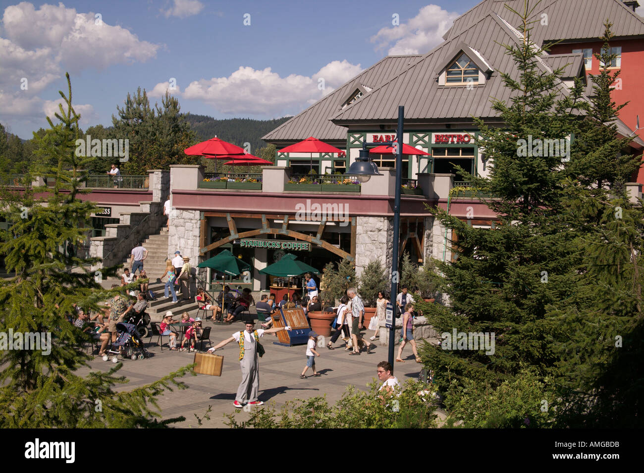 Mime performs in plaza near Starbucks Coffee at Whistler Village Whistler British Columbia Canada - Stock Image