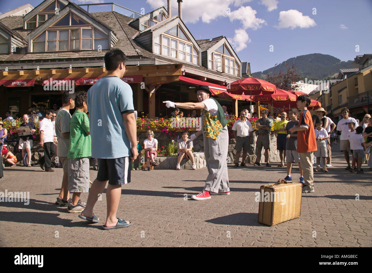 Mime entertains tourists on the Village Square at Whistler Village Whistler British Columbia Canada - Stock Image